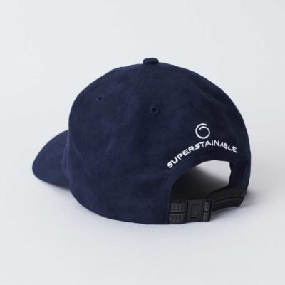 Pack shot of the back of the organic navy cap Seierø with suede look