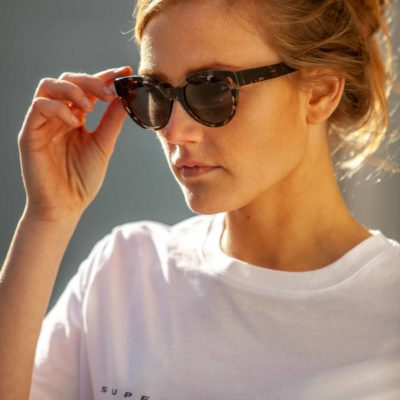 Model wearing the DICK MOBY® ORY Crystal Havana sunglasses