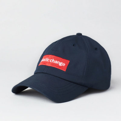 Pack shot of the front of the Plastic Change signature cap