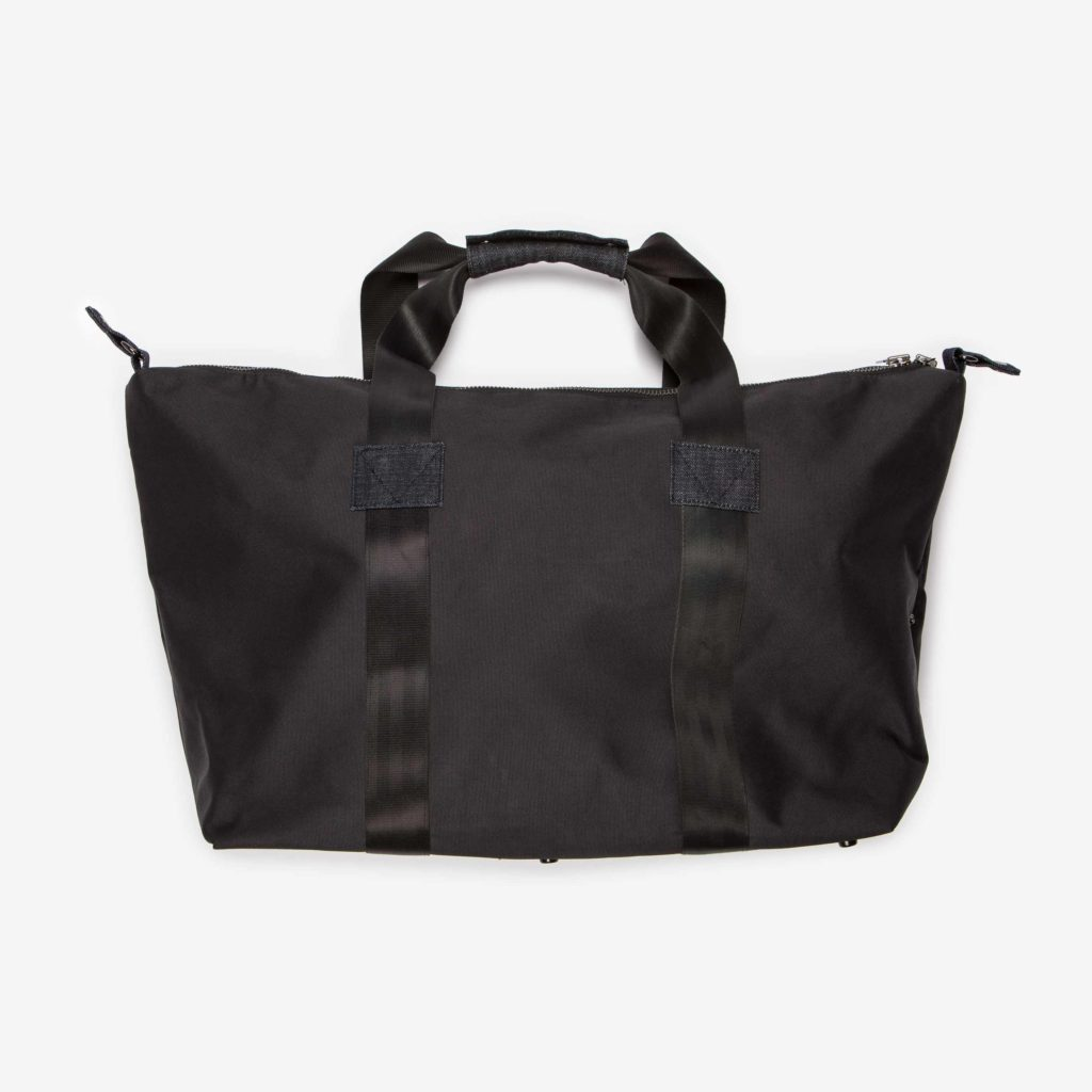 Back side of the unbuttoned black Weekend Bag