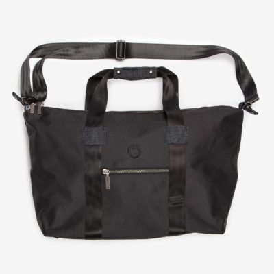 Side view of the black Weekend Bag with the shoulder strap mounted