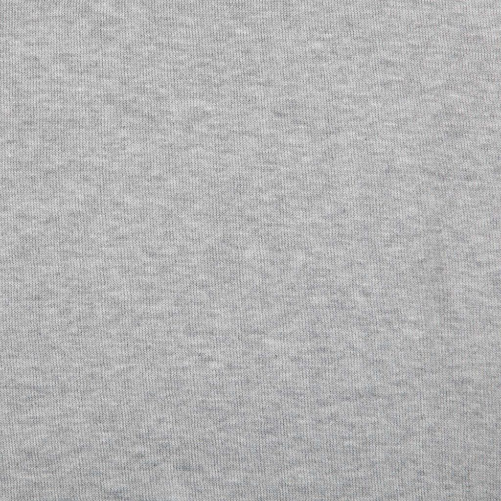 Detail view of the fabric of the grey melange organic cotton roll neck