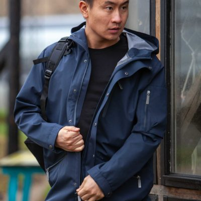 Model wearing the Glombak Navy jacket with hood