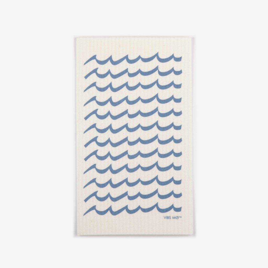Blue sustainable dish cloth designed by Vibs Mø with a graphic print of waves