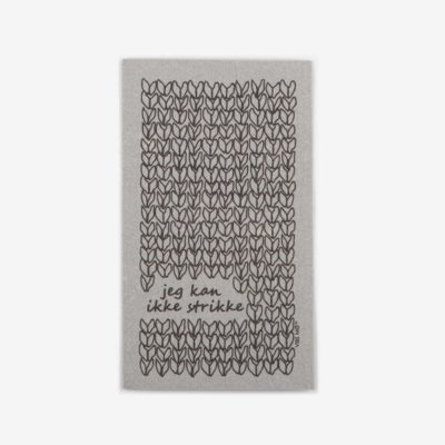 "Grey sustainable dish cloth designed by Vibs Mø with the text ""jeg kan ikke strikke"" printed on it"