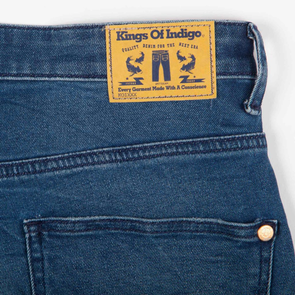Detail view of the brand label on the Kings of Indigo Christina High jeans