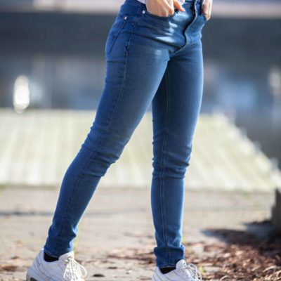 Side view of model wearing the Kings of Indigo Christina High jeans