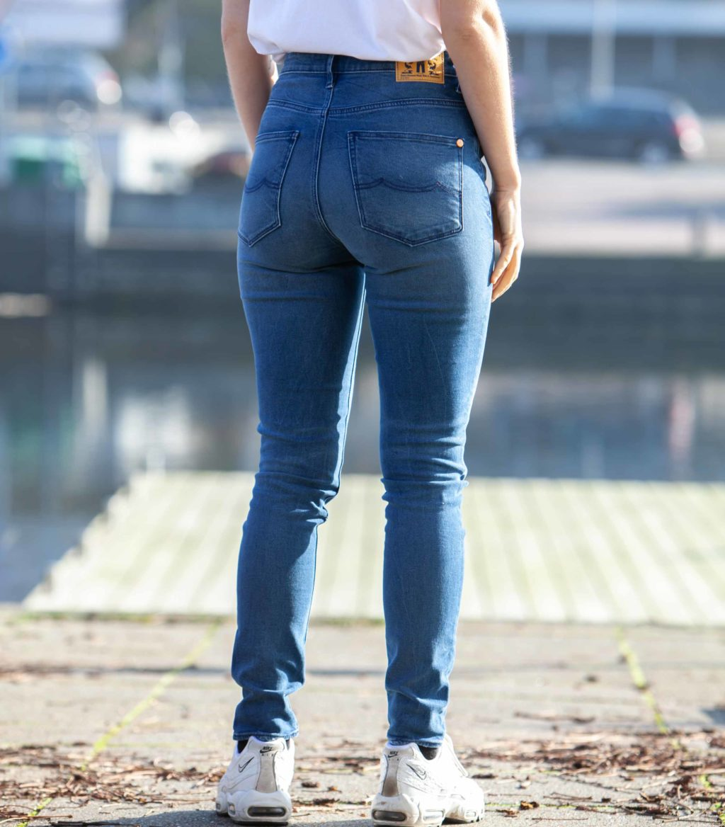 Back view of model wearing the Kings of Indigo Christina High jeans