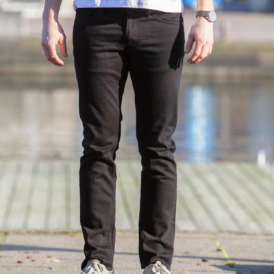 Front view of model wearing the Kings of Indigo Charles Stay Black jeans