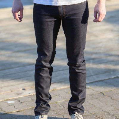 Front view of model wearing the Kings of Indigo jeans - model Ryan Dry Comfort Stretch