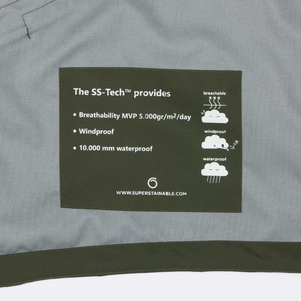 Detail view of the inner label of the green Glombak jacket