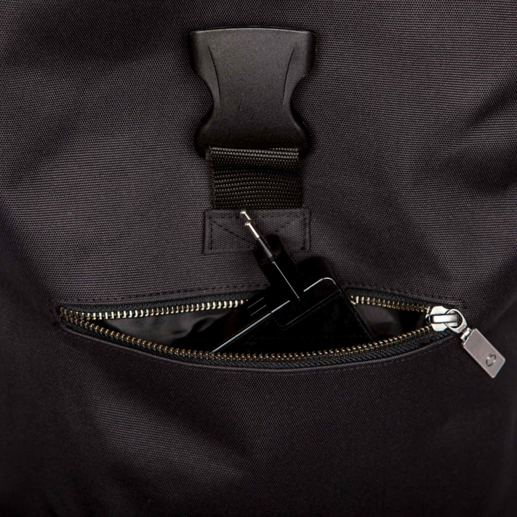 Detail view of the front pocket of the sustainable black backpack from Superstainable