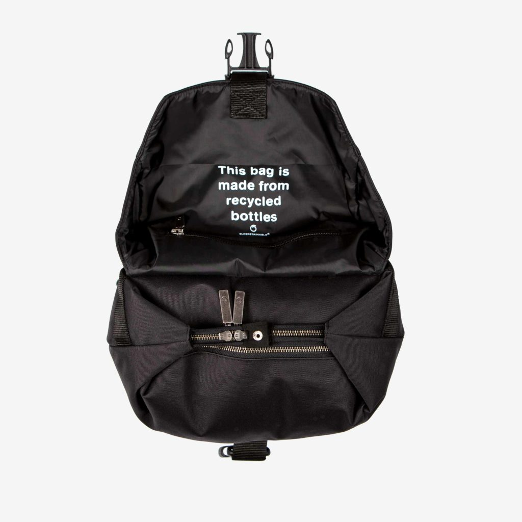 Top view of the semi-open sustainable black backpack from Superstainable with the inside button closed