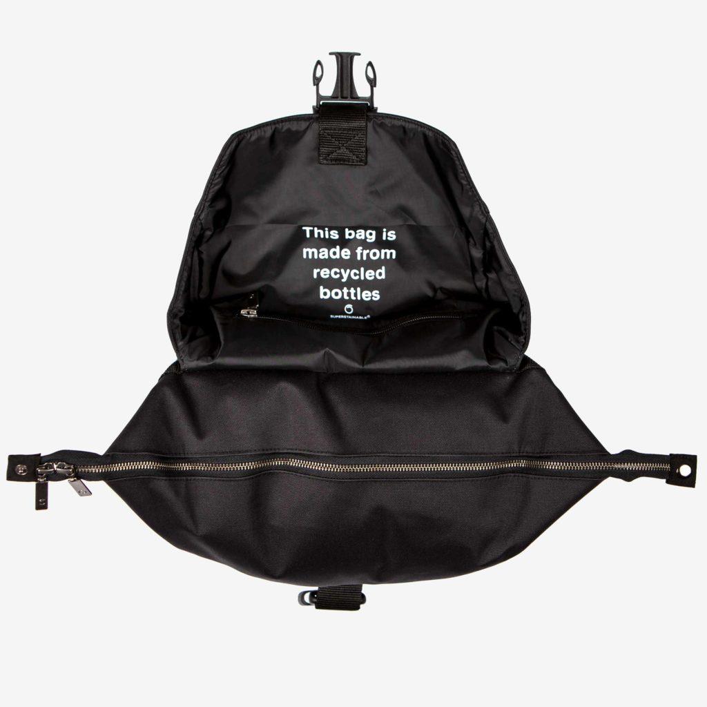 Top view of the semi-open sustainable black backpack from Superstainable with the inside button open